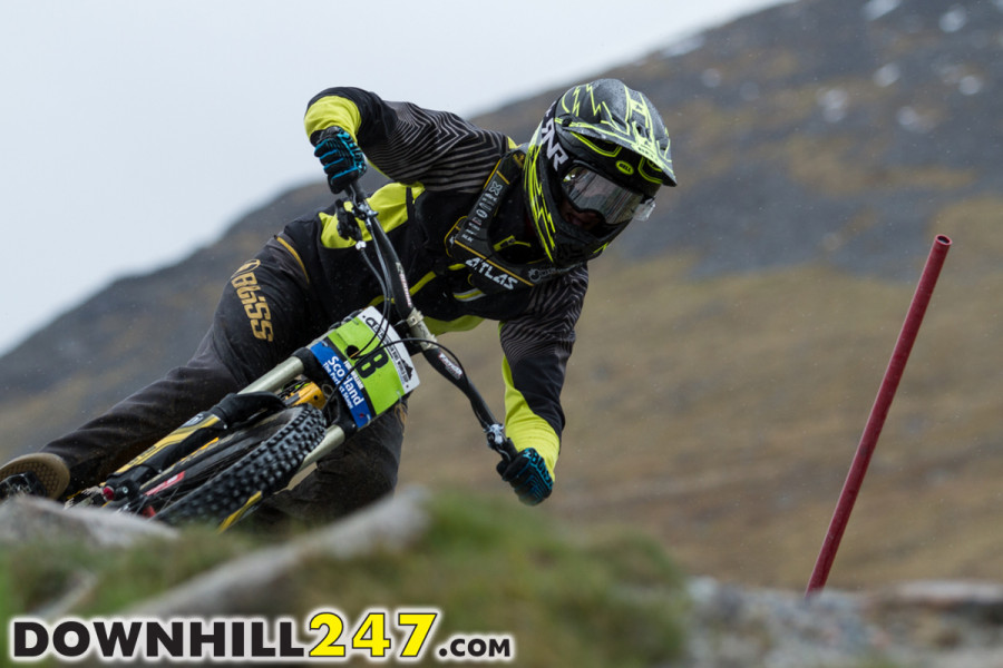 Jacob Dickson laying it over towards the higher end of the track where it is still in the open.